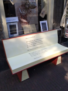 In front of a canal-side bookstore in Delft is this invitation to sit, read and be.