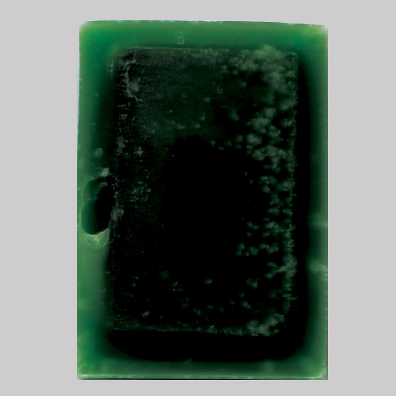 A5 green, 2012 found encyclopaedia, paraffin wax, dye 21cm x 15cm x 5cm